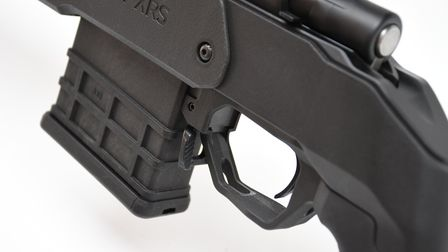 Close up of the ambidextrous mag release on the trigger guard of the Howa 1500 Carbon 6.5 Creedmoor in MDT XRS Chassis