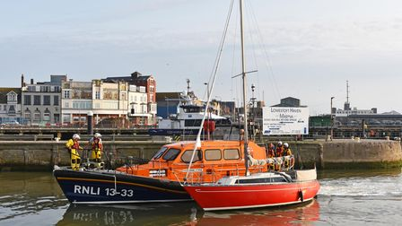 Lowestoft RNLI relief lifeboat, Bridie O'Shea, with the 32ft Dutch yacht inLowestoft.