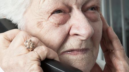 older woman using a telephone