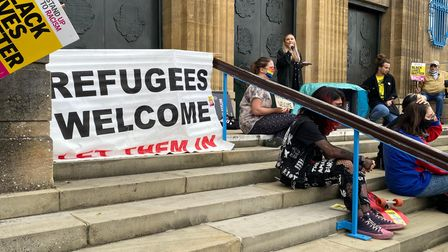 A 'refugees welcome' banner outside City Hall in Norwich as part of a protest in response to the Afghanistan crisis
