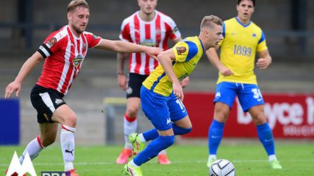 Keelan O'Connell of Torquay United on the break from Jake Moult, Captain of Altrincham during the N