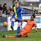 Ed Hottor (tackling) was among the scorers for St Ives Town in their win at Stourbridge.