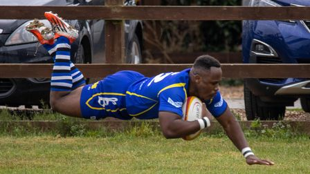 Albie Tayedzerwa dives over to score for St Ives at Cambridge.