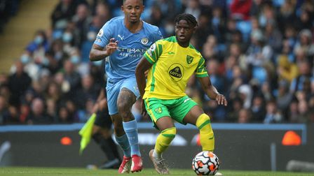 Bali Mumba of Norwich and Gabriel Jesus of Manchester City in action during the Premier League match