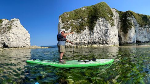 Old Harry Rocks on a calm day, ideal conditions for paddle boarding