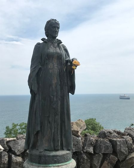The Lady Mount Temple statue, alwayswith fresh flowers in her hand.