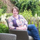 Romantic novelist Suzanne Snow in her garden at Hesketh Bank