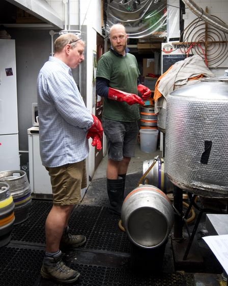 Garden City Brewery'sNick Rolfe explains the brewing process, while crafting the special FA Cup anniversary ale
