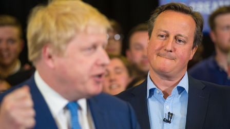 David Cameron watches Boris Johnson at a Tory party event