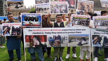 Former Afghan interpreters and veterans hold a demonstration in Parliament Square, London, calling f