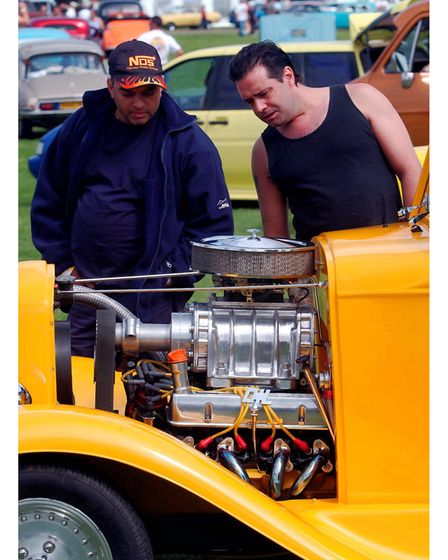 Admiring one of the vehicles at theNASC Hot Rod show at the Suffolk Showground in 2004