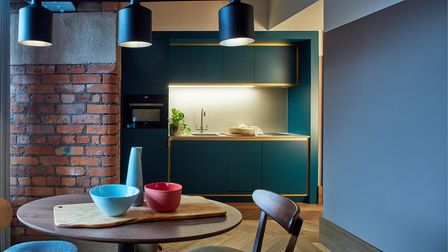 Native Manchester interiors kitchen dining area industrial vibe with brickwork wall and steel lamps