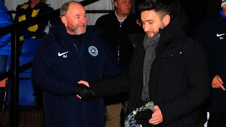 Lee Johnson, then manager of Bristol City, shakes his dad's hand - Gary Johnson, manager of Torquay United Photo: Tom...