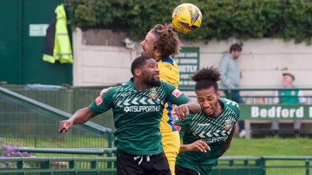 Shaun Lucien and recent signing Lewis Wilson challenge for the ball