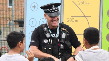 PC Dom Woodmansee chats to the local children and gives out stickers during the community action day