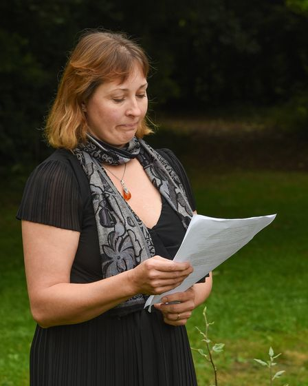 Marcia Hughes speaks during the unveiling of a memorial tree at Loch Neaton in Watton
