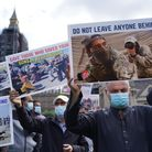 Former Afghan interpreters and veterans hold a demonstration in Parliament Square