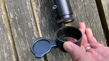 Close up of the removable flip-up lens covers on the PAO Topaz Pre-Mount air rifle scope