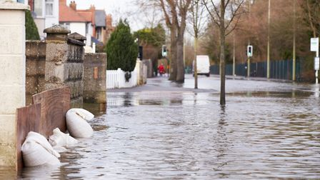 Sandbags Outside House On Flooded Road. Picture: Getty Images/iStockphoto