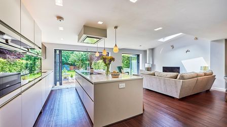 The living/kitchen/dining room overlooks the rear garden.