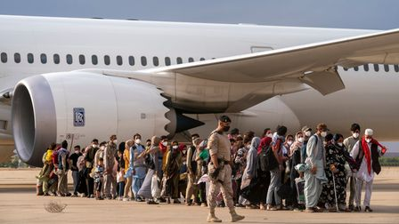 Afghan refugees disembark at the Torrejon military base as part of the evacuation process in Madrid