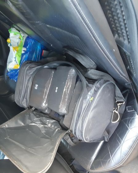 17 kilos of heroin seized fromholdall on the back seat ofMohamed Ibrahim's car.