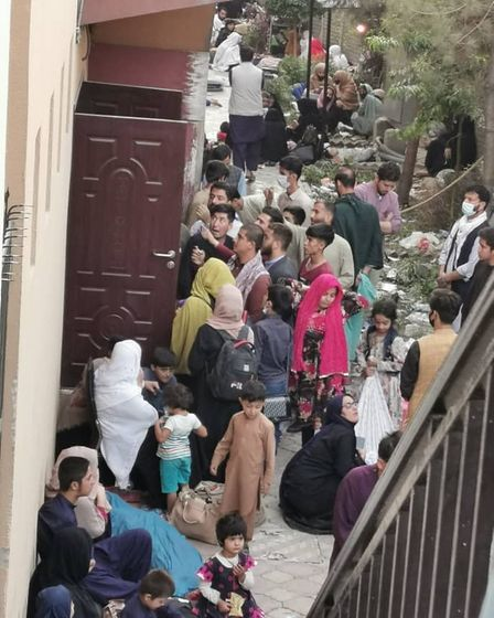 People in Kabul outside a hotel where Ashna Shinwari had been staying ahead of his flight home