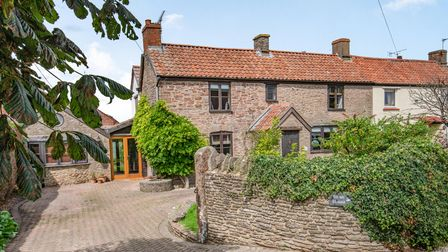 Stone two-storey cottage exterior with stone wall, driveway and side extension in St Marys Grove Nailsea