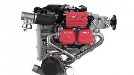 The Rotax 915iS engine on white background