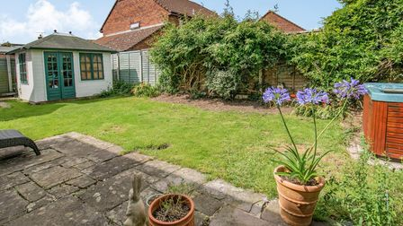 Lawned garden with patio, plants, hot tub and summerhouse in the cottage in St Marys Grove, Nailsea