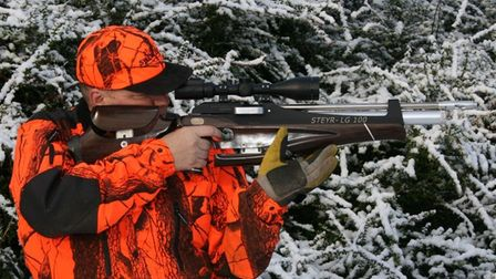 Gary Chillingworth shooting a PCP air rifle in snowy woodland, freehand
