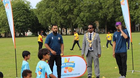 Coach and London Sportif club director Muhi Mikdad with local young people.
