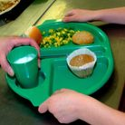 File photo dated 28/08/09 of a school meal being served as around 900,000 children from low-income f