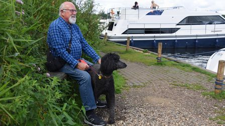 David Furbur, and his dog Amy, enjoying the sunny warm weather by the boats at Salhouse Broad. Pictu