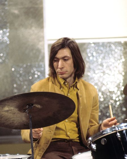 File photo dated 12/11/68 of Charlie Watts, drummer with the Rolling Stones, as the band film at the
