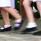 File photo date 15/07/14 of a generic stock photo of school girls walking to school. Many children a