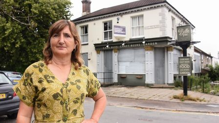Councillor Lucy Galvin with the boarded up Belle Vue pub in St Philips Road. Picture: DENISE BRADLEY