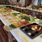 Table with flowers, vegetables, at the Clavering Horticultural Society show, Essex