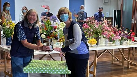 Anne Rivett and Angela Bailey holding the Mrs Maine Memorial Bowl for the rose section,Clavering Horticultural Society