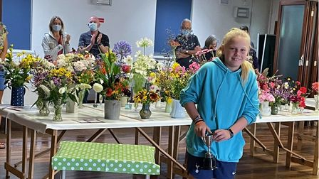 Elizabeth Balaam is applauded as she winscups in the 2021 Clavering Horticultural Society show, Essex