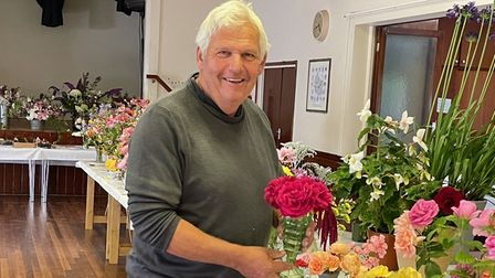 Clavering Horticultural Society Chairman Richard Bailey holding a vase of roses, Clavering, Essex