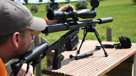 Chris Parkin shooting the Barrett 98B Field from a bench, lowering the hinged stock