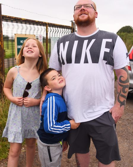 Andy Browse and his children, Ruby, eight, and James, five, watch as the Red Arrows arrive at Norwic