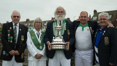 Huntingdonshire Bowls celebrate their win in the Adams Trophy.