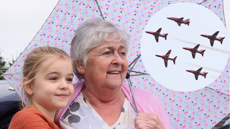 Julie Fowler and her granddaughter Ella, five, watch as the Red Arrows arrive at Norwich Airport
