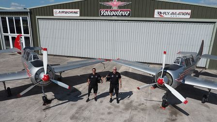 Team Phoenix - Mike Wildeman (right) and Alan Robinson - with their Yak-52 aircraft