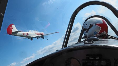 Alan Robinson flying in close formation with team mate Mike Wildeman in Yak-52, image taken from behind pilot Alan's head