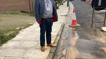 District council leader Cllr Chris White inspects the leaks in Cavendish Road, St Albans.