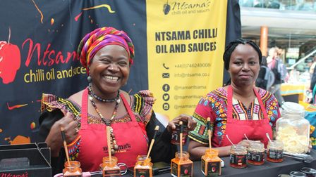Joyce and Ntsama selling at Norwich's African and Caribbean Market, at The Forum
