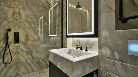 Bookmatched cream marble bathroom from stoneCIRCLE factory in Basingstoke